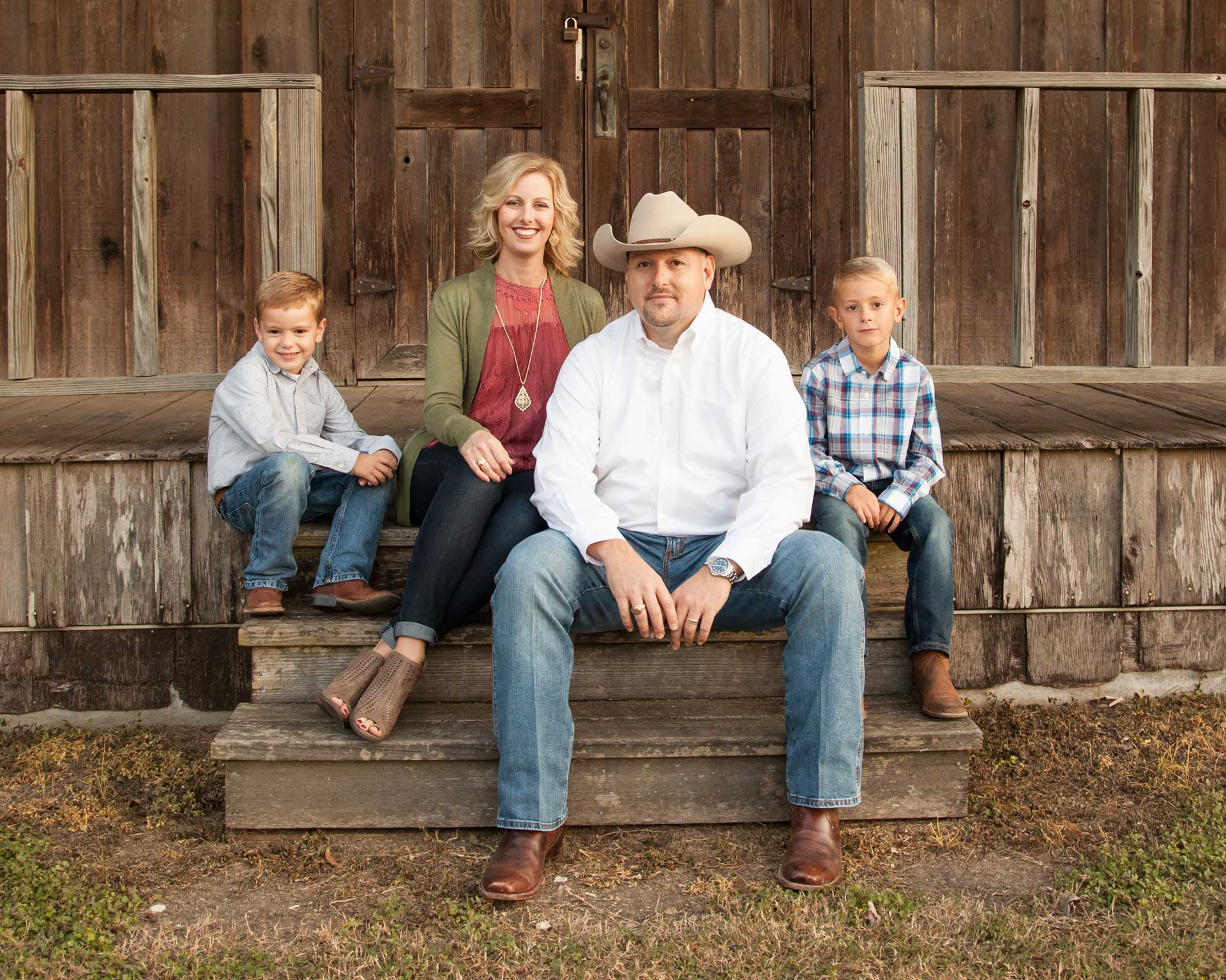 Photo of Trent Nichols with his wife and 2 young boys